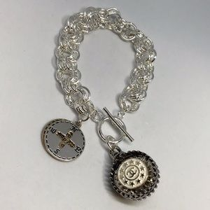 Sterling silver Authentic coco button with charm.